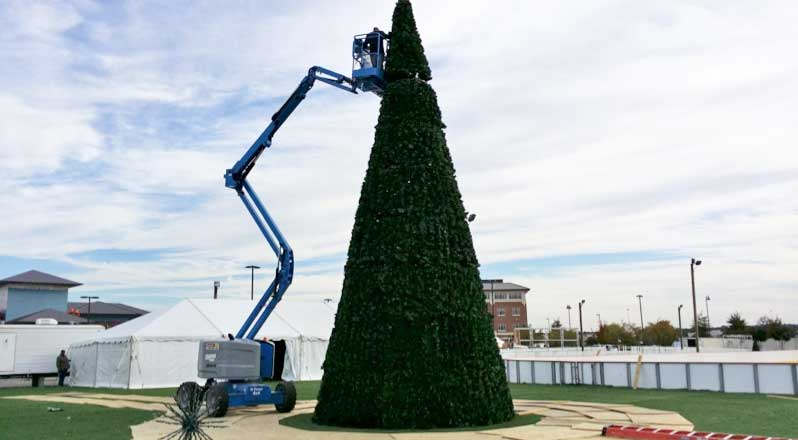 The final section of the tree is put in place.